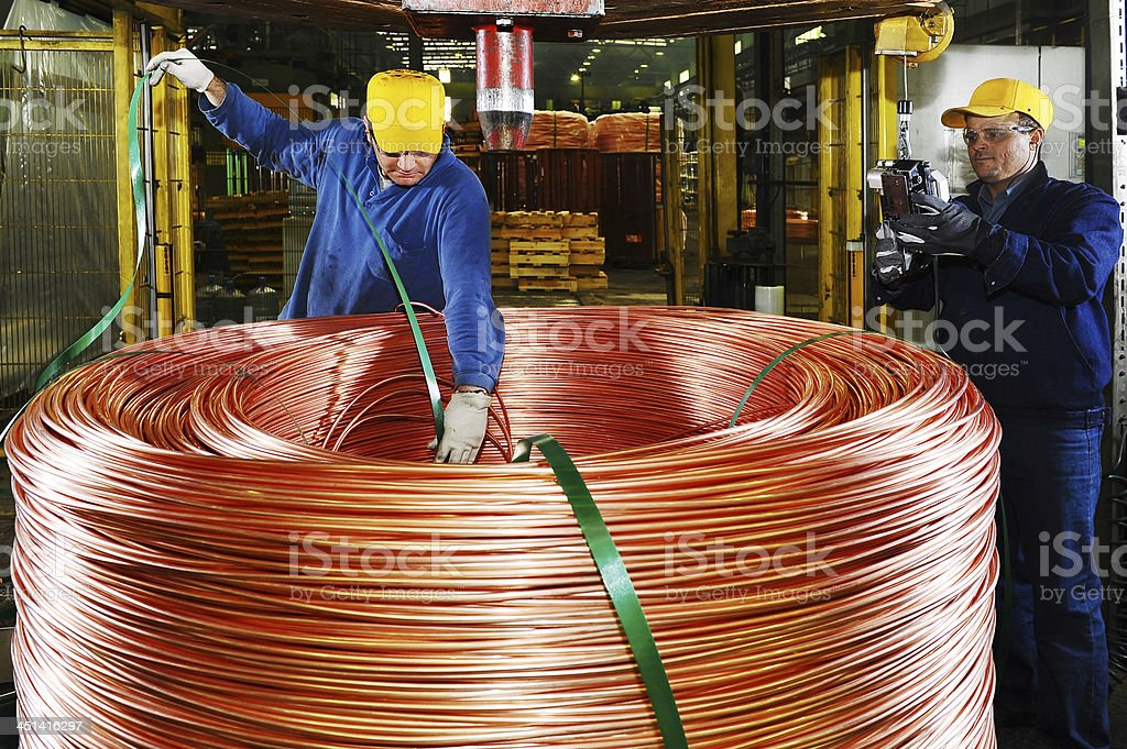 Preparing large spool of copper wire for delivery stock photo