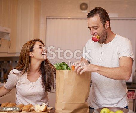 istock Preparing meals together 608585426