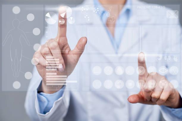 preparing medical report - business woman hologram imagens e fotografias de stock