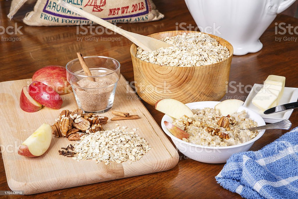 Preparing Oatmeal with Nuts and Spices royalty-free stock photo
