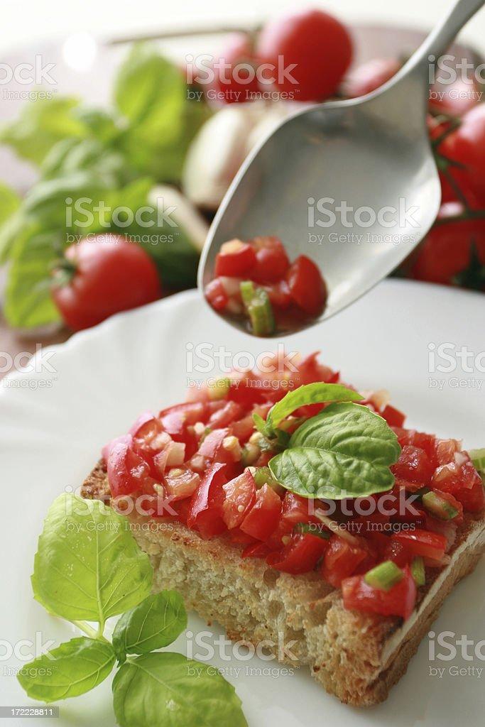 Preparing of bruschetta. royalty-free stock photo