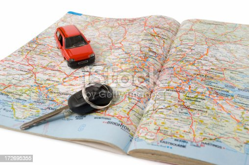 Road map with car key and toy car. Related images:
