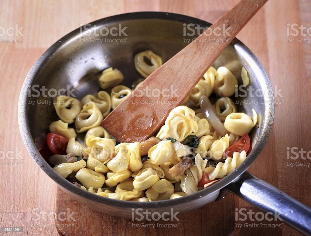 Preparing pasta dish royalty-free stock photo