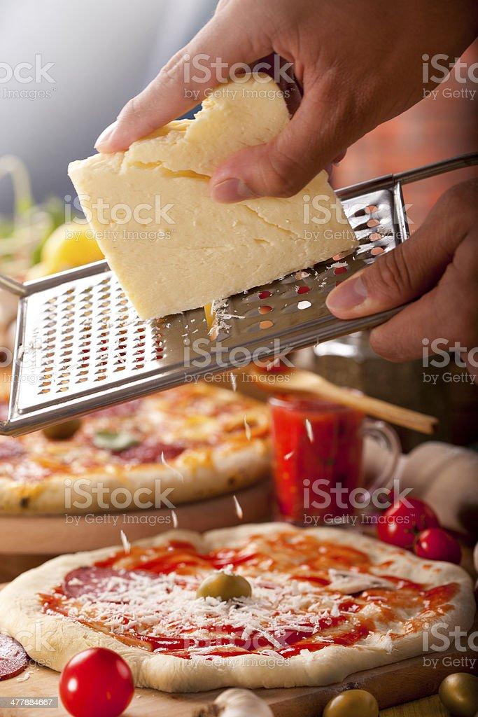 Preparing pizza royalty-free stock photo