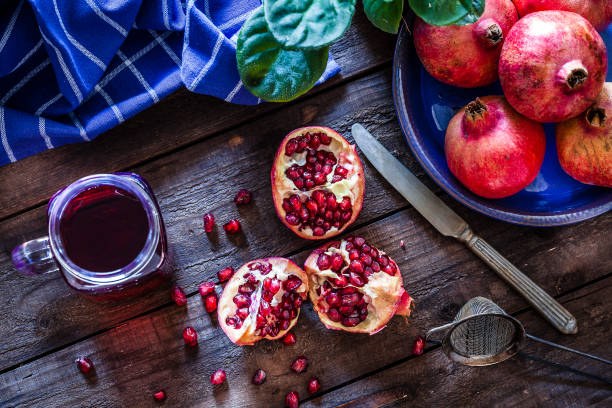 preparing pomegranate juice - pomegranate stock photos and pictures