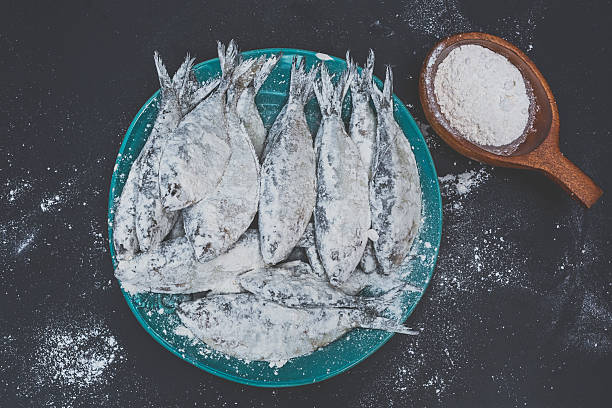 Preparing Sardines to Fry stock photo