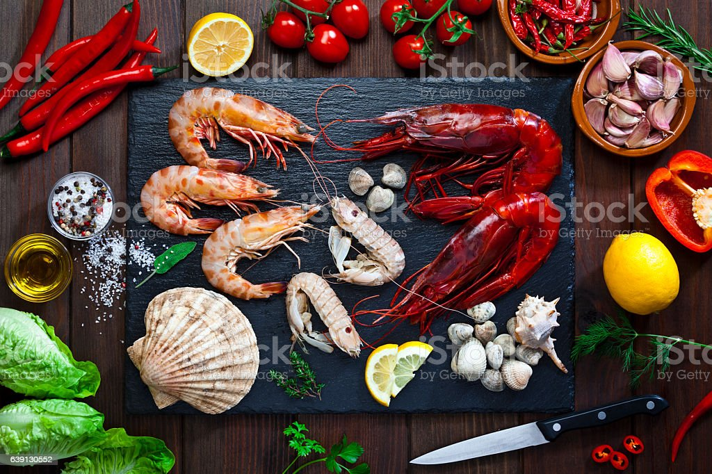 Preparing seafood for cooking stock photo