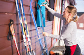Woman is preparing her skis for next day Back Country skiing at Hardangervidda plane in Norway. It is the beginning of May on sunny day in the biggest National Park in Europe and the last days of Skiing season in NP.