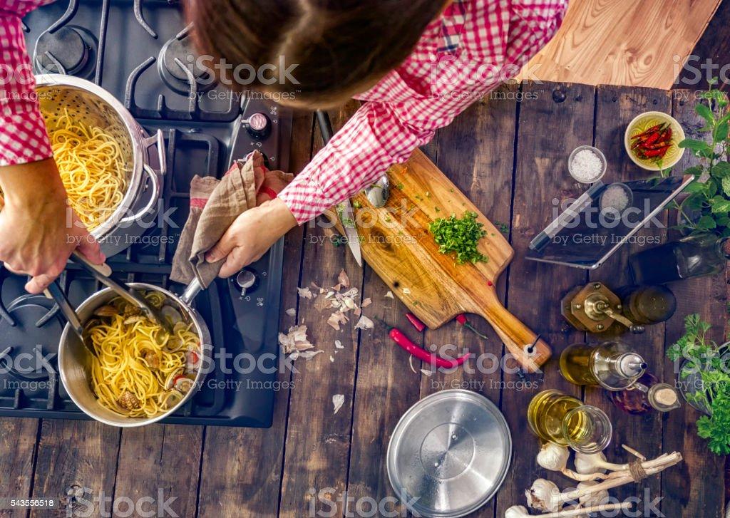 Preparing Spaghetti alla Vongole stock photo