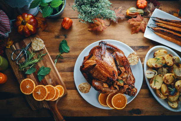 Preparing Stuffed Turkey for Holidays in Domestic Kitchen stock photo