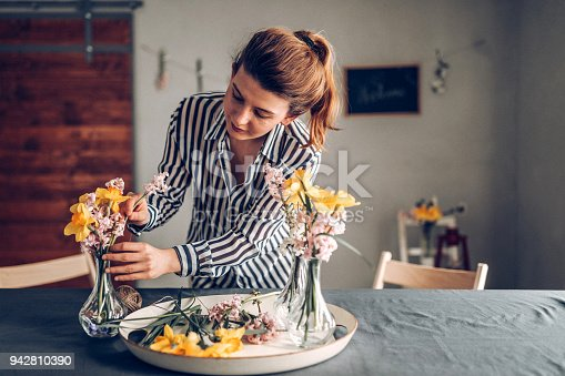 Young woman preparing dinner table