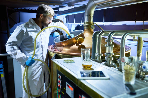 preparing tank for beer fermentation - brewery tanks stock pictures, royalty-free photos & images