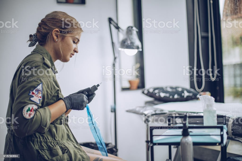 Preparing tattoo machine stock photo