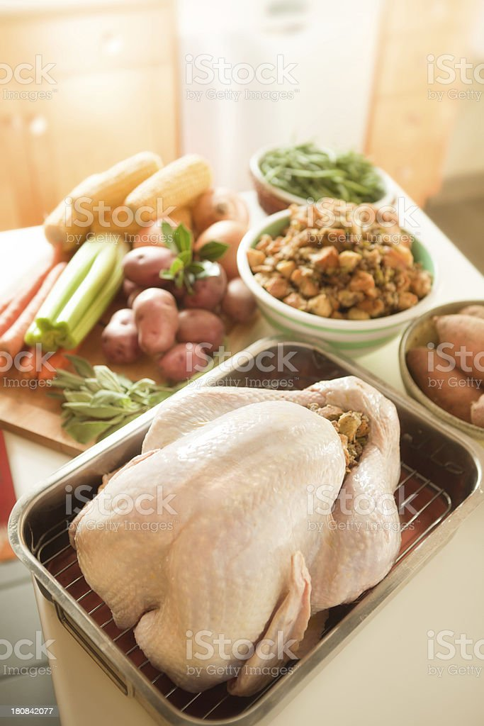 Preparing Thanksgiving Dinner with Turkey, Stuffing, and Trimmings Vertical stock photo