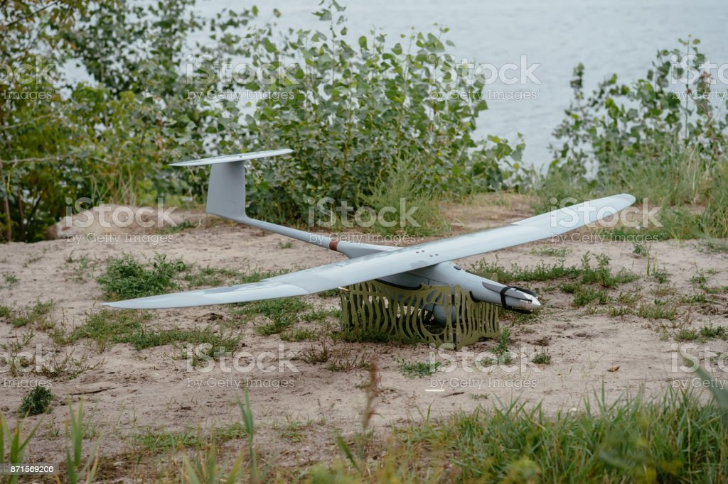 Preparing the army drones for the mission. Reconnaissance aircraft in the wild. stock photo