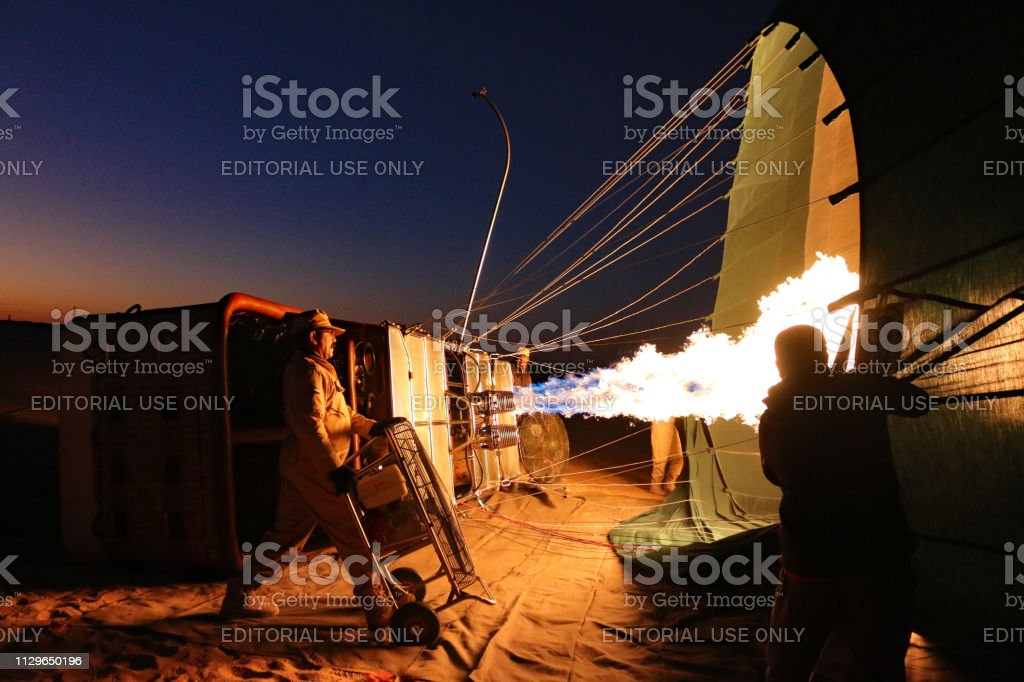 Preparing the hot air balloon for takeoff. stock photo
