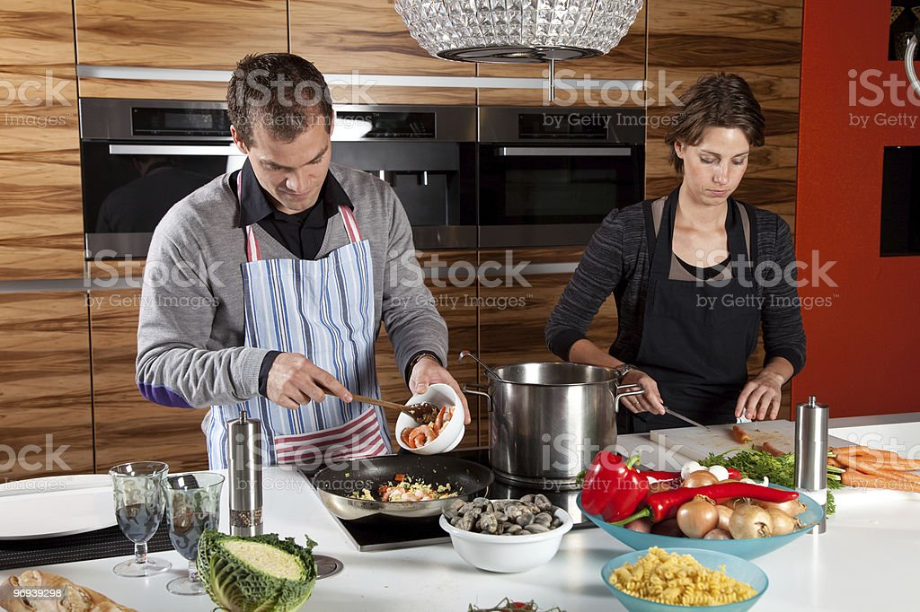Preparing the meal together royalty-free stock photo