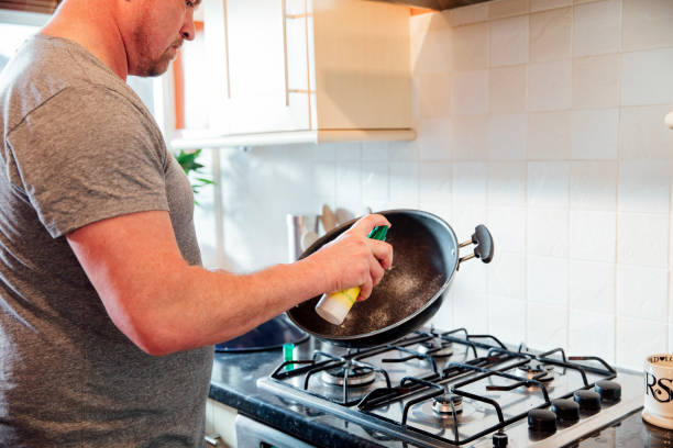 Preparing the Pan with Frying Oil stock photo