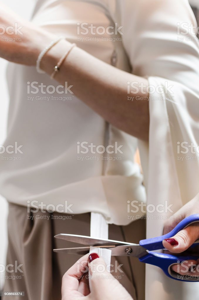 Preparing the sewing,  Cutting out material stock photo