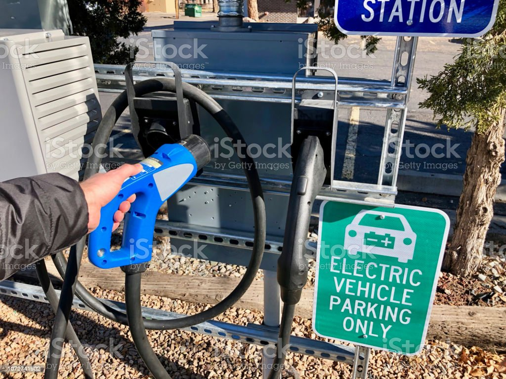 Preparing to Charge an Electric Vehicle stock photo
