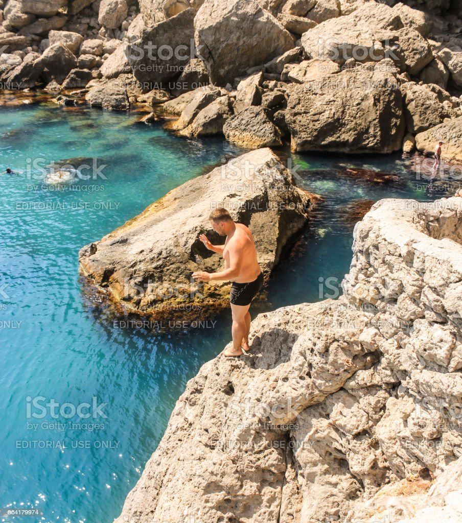 Preparing to jump from the cliff. royalty-free stock photo