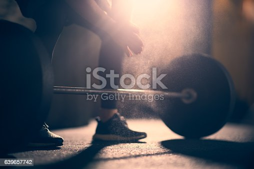 istock Preparing to lift dumbell in a gym 639657742