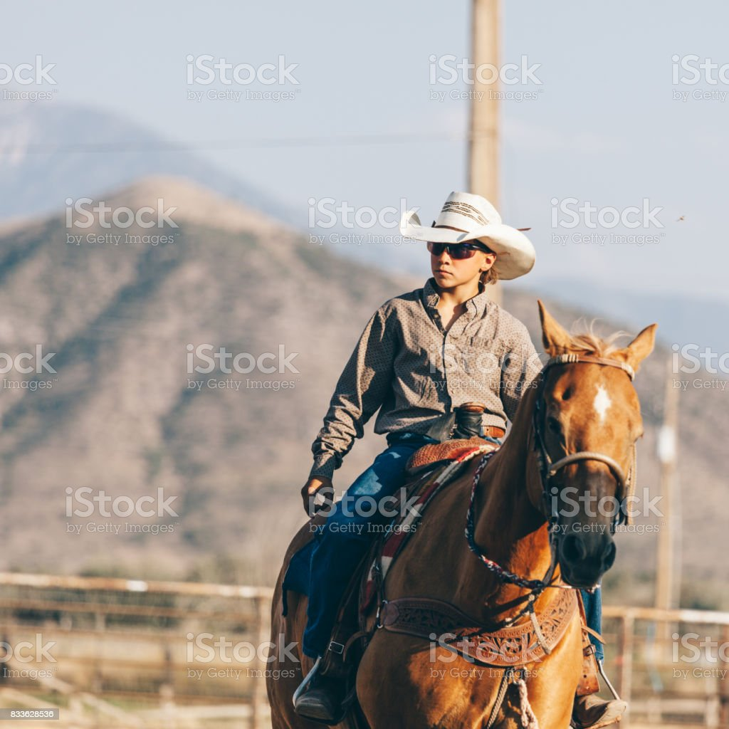 preparing to ride in the rodeo stock photo