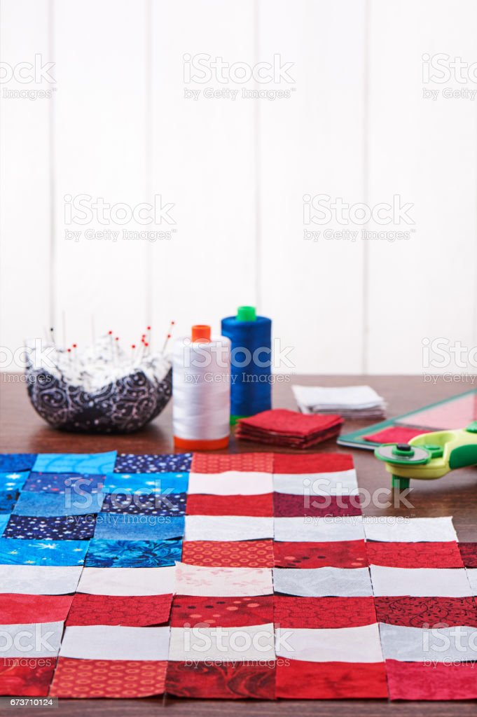 Preparing to sewing of pieces of fabrics that look like a flag of USA stock photo