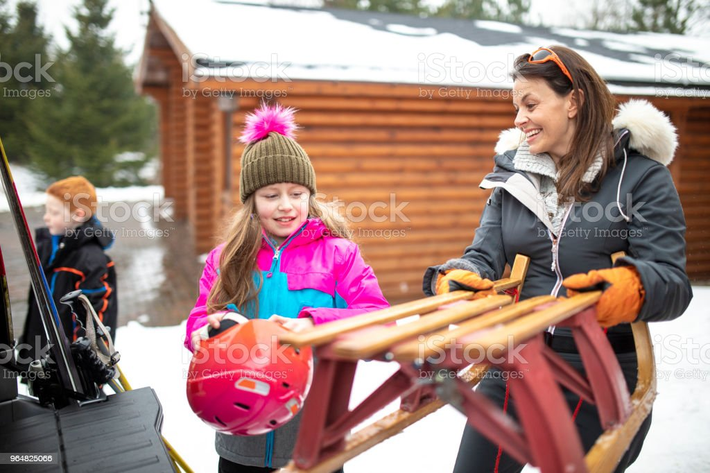 Preparing to Sled with her Daughter royalty-free stock photo