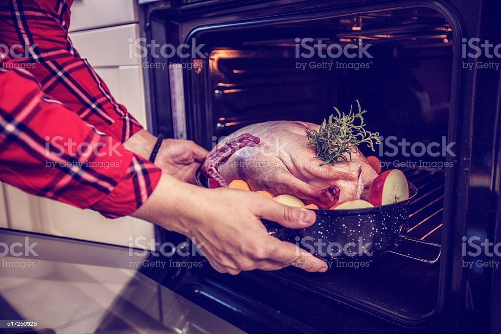 Preparing Traditional Holiday Goose with Side Dishes stock photo