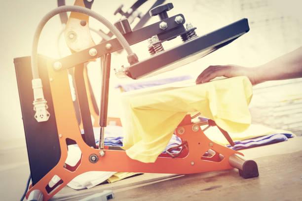 Preparing t-shirt for printing in the silk screen printing machine stock photo