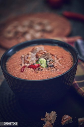 istock Preparing Vegetable Gazpacho Soup with Tomato, Cucumber, Paprika and Herbs 1253087209