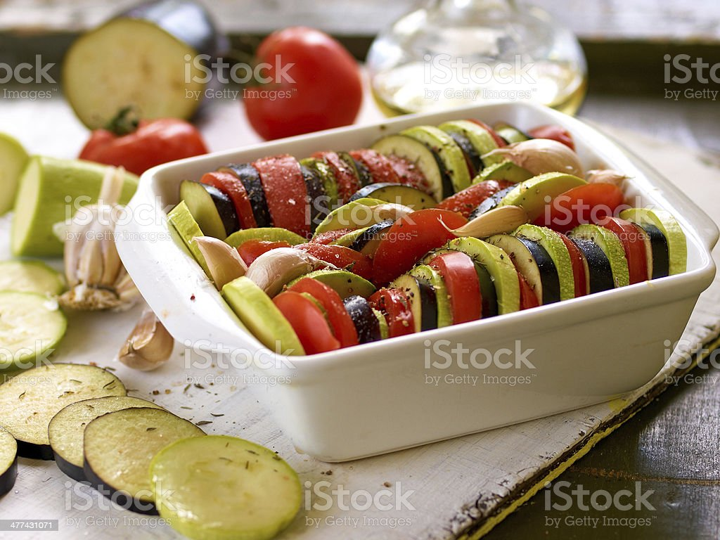 Preparing vegetable ratatouille on a wooden background stock photo