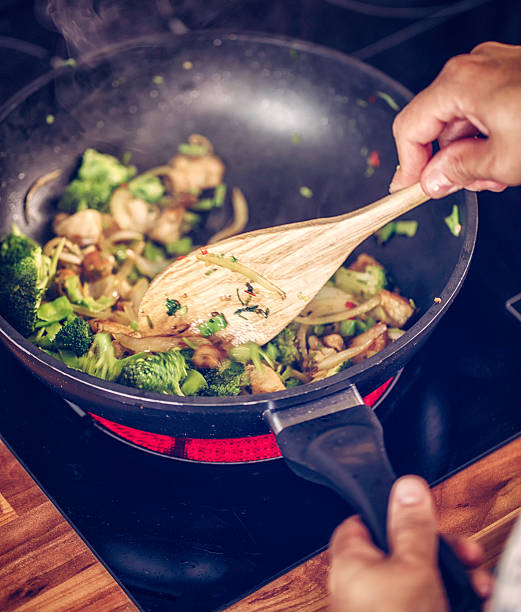 Preparing Vegetables and Chicken in a Wok for Nasi Goreng stock photo