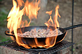 Preparing venison outdoors on a Do It Yourself cooking chimney