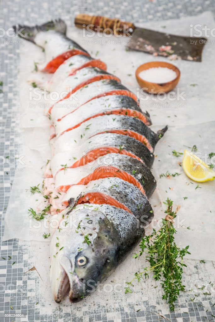 19b55113f302 Preparing Whole Salmon With Thyme And Salt Stock Photo   More ...
