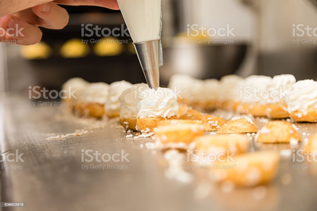 prepating cake with a icing bag stock photo