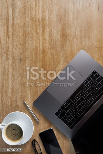 High angle shot of a productive workspace over a wooden surface