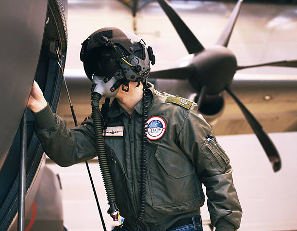 Prepping for war Shot of a fighter pilot inspecting his aircraft air force stock pictures, royalty-free photos & images