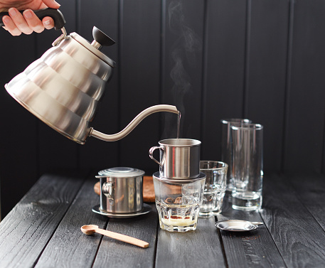 Preraring Drip Coffee Vietnamese Style Woman Hand Pouring Steaming Hot Water From Goose Neck Kettle Into Metal Coffee Maker Phin On Black Background Stock Photo Download Image Now Istock