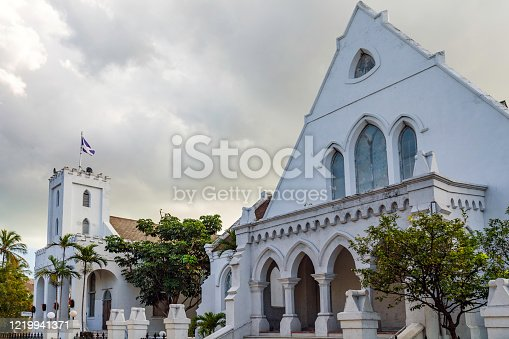 Presbyterian Church and grounds with flog flying over its Bell Tower in Nassau, The Bahamas