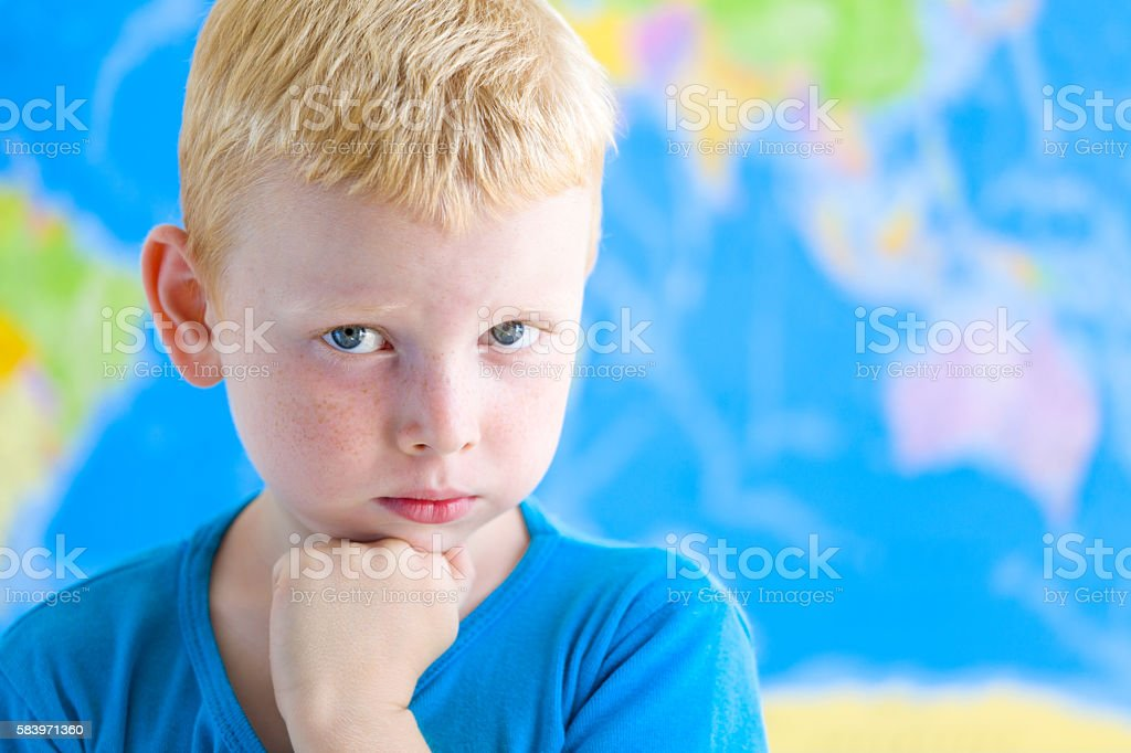 Preschool boy dreaming in fron of  world map stock photo