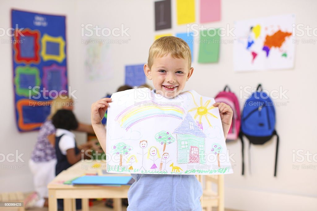Preschool boy holding up artwork royalty-free stock photo
