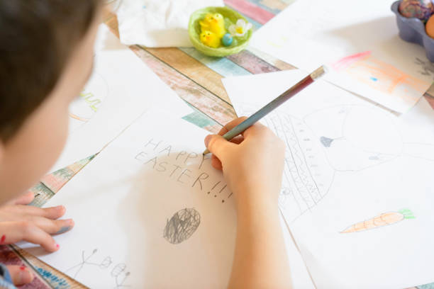 Preschool boy making Greating Cards for Easter. stock photo