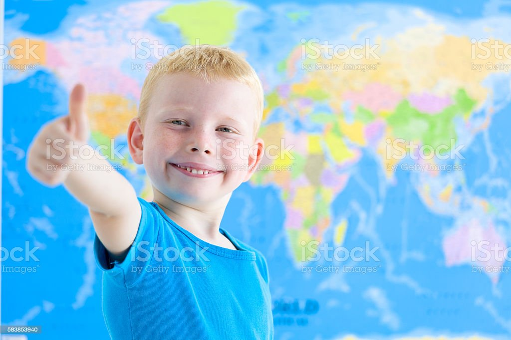 Preschool boy with world map stock photo