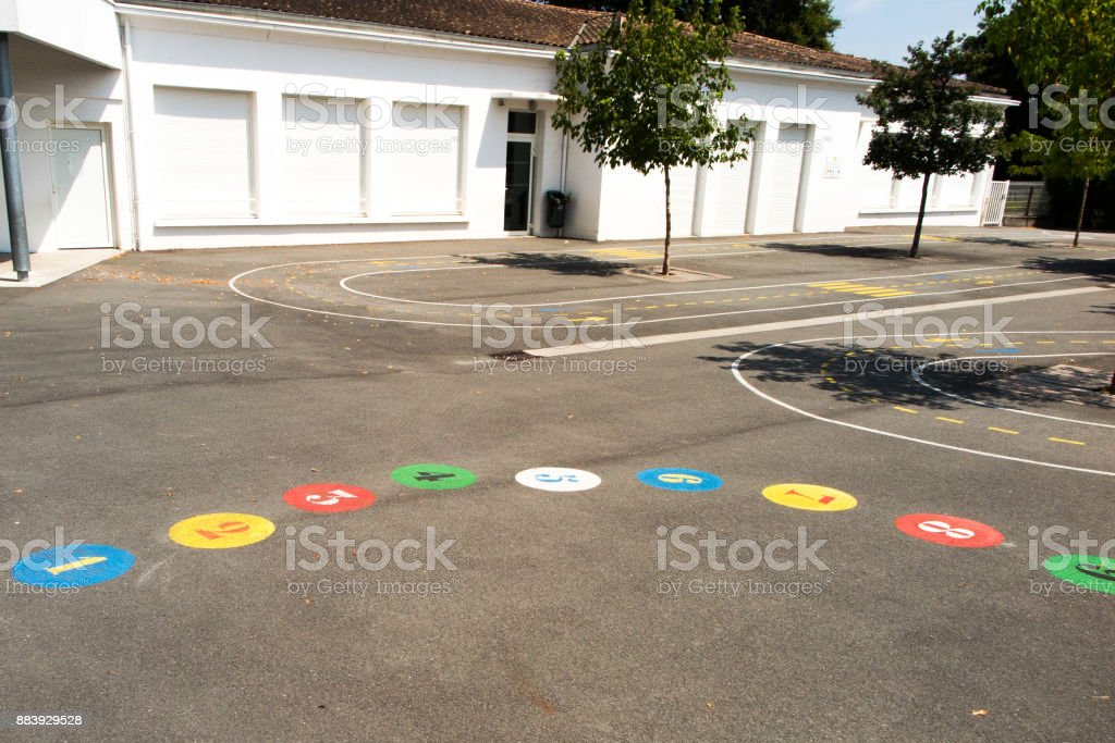 Preschool building exterior with playground on a sunny day stock photo