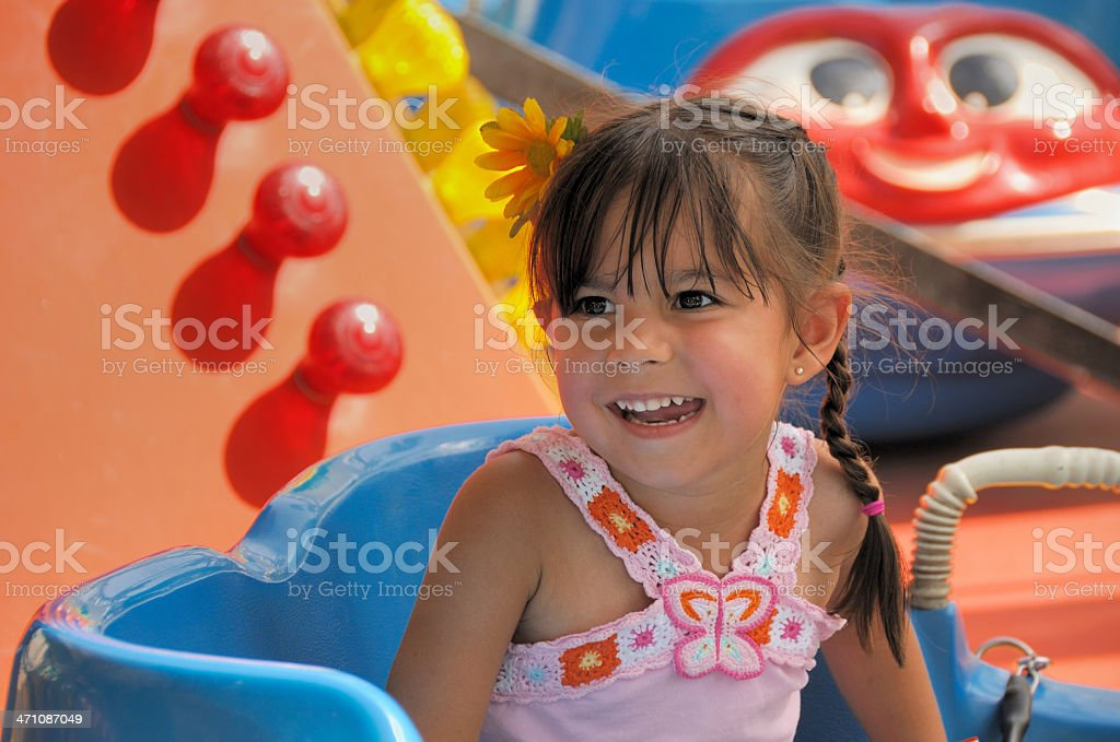 Preschool child on a carnival ride royalty-free stock photo
