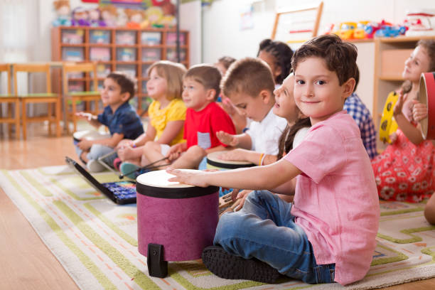 Preschool Child Preschool child in classroom. elementary age stock pictures, royalty-free photos & images