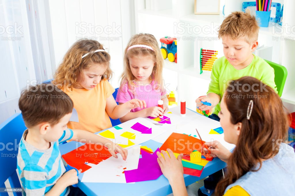 Preschool: Children Craft Activities with color paper and glue. stock photo