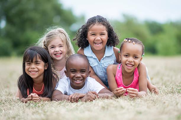 Preschool Children in a Dog Pile 스톡 사진